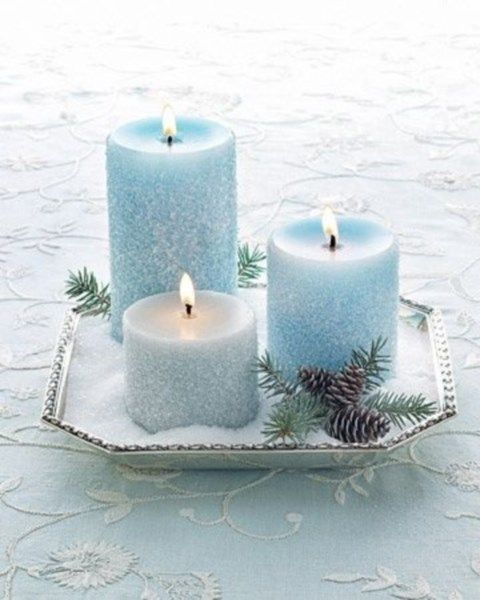 snowy ice blue candles on a tray with faux snow