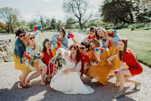 The bride chose 9 bridesmaids, and let them choose red and orange dresses