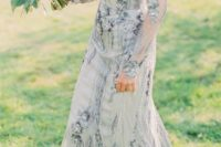 02 blue silver wedding dress with intricate embellishments and an illusion neckline