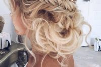 02 braided messy updo with a flower hairpiece will be great for boho brides