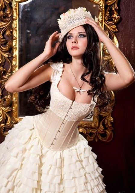 chic and sexy steampunk bride in a ruffled dress with a corset and a hat
