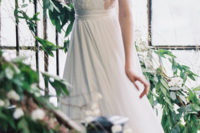 02 lace top and cap sleeves wedding dress with a plunging neckline