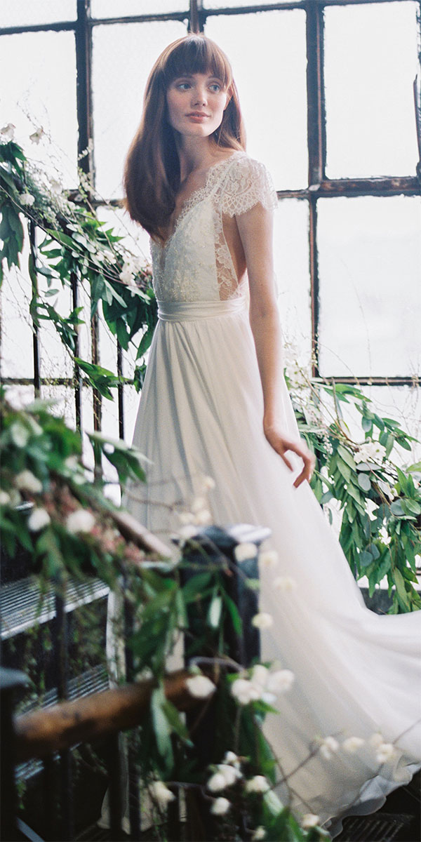 lace top and cap sleeves wedding dress with a plunging neckline