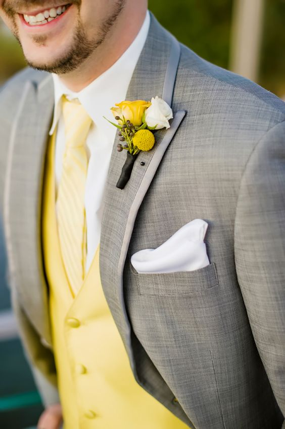light grey suit with a yellow vest, tie and boutonniere, add crispy white to make the look bolder
