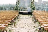 02 rooftop wedding aisle with petals and lanterns
