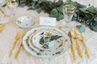 03 Gilded details, patterned porcelain and greenery made the table setting gorgeous