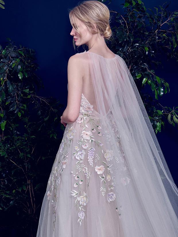 The dress has a tulle cape as a unique feature