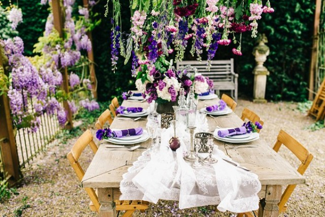The table setting is refined, with an airy fabric table runner, sophisiticated tableware and silver candle holders