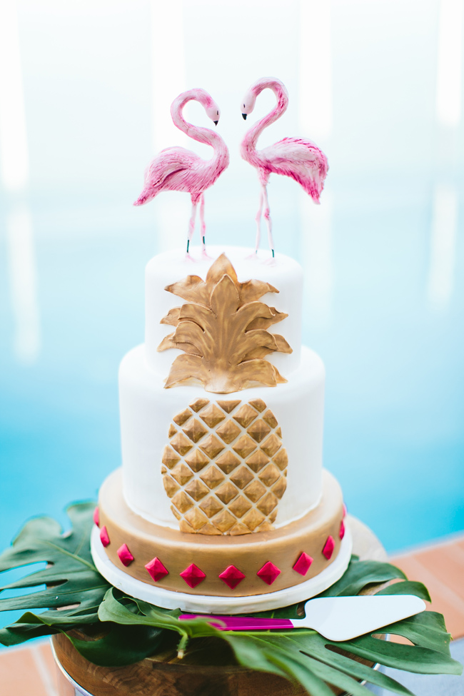 The wedding cake was an embellished one, with pink flamingo toppers