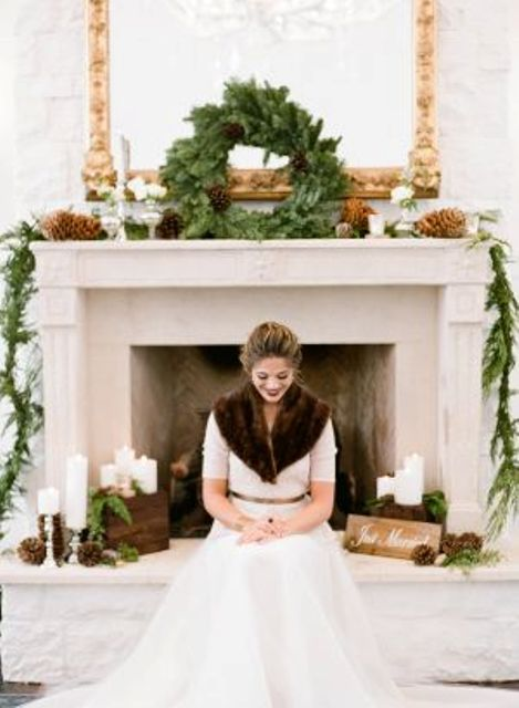 an evergreen wreath with pinecones for a rustic winter wedding backdrop
