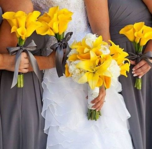 dark grey bridesmaids' dresses, yellow calla lilies