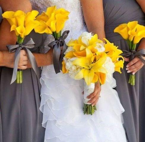 dark grey bridesmaids' dresses, yellow calla lilies