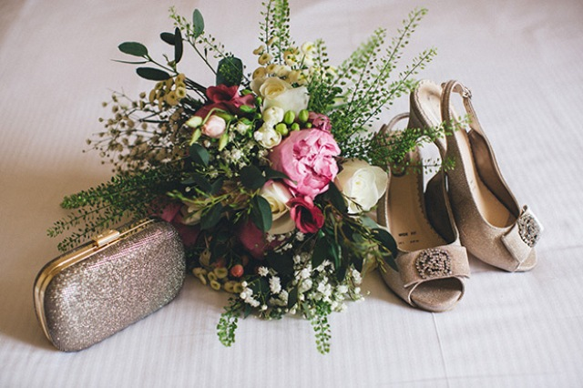 neutral glitter shoes and clutch along with a textural bouquet finished her look