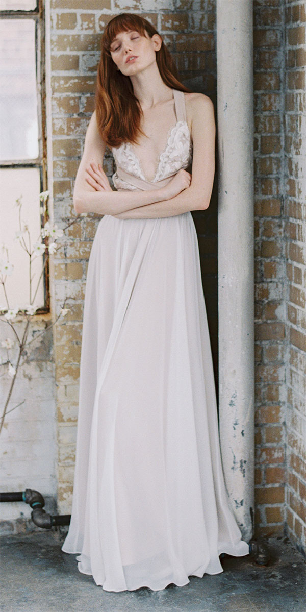 neutral wedding dress with straps and a plunging neckline