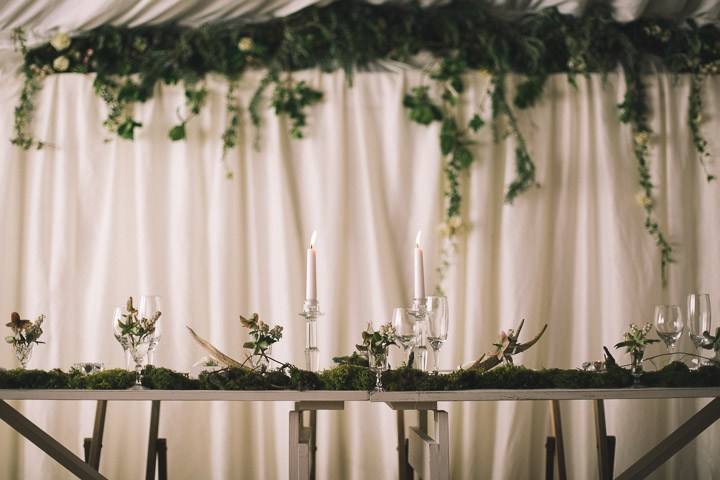 Antlers, moss, branches and greenery were used for decorating tables and the venue