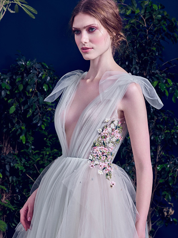 Grey tulle plunging neckline dress with colorful flower appliques on the sides