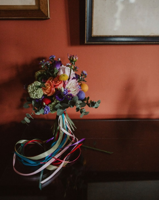 The bridal bouquet was a very bold one, with billy balls and colorful pompoms