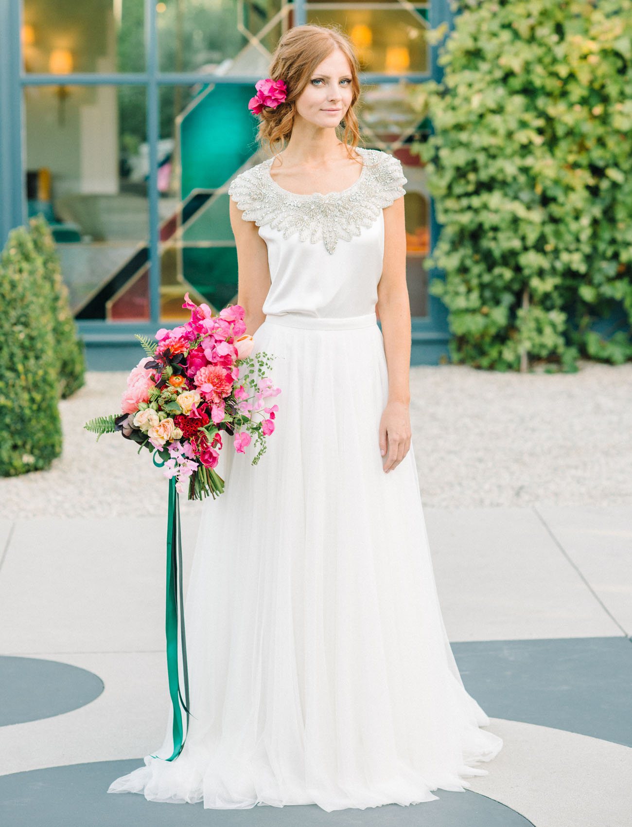 The bride was wearing a two piece dress, which is another hot trend, and the gown is beautifully embellished