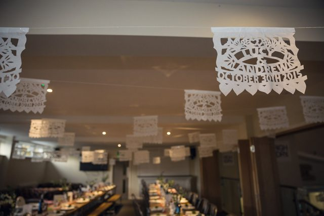 White paper picado was used to decorate the venue
