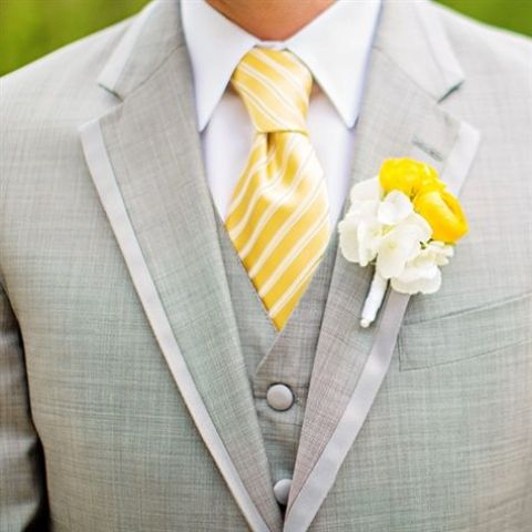 dove grey suit, a crispy white shirt and a striped yellow tie
