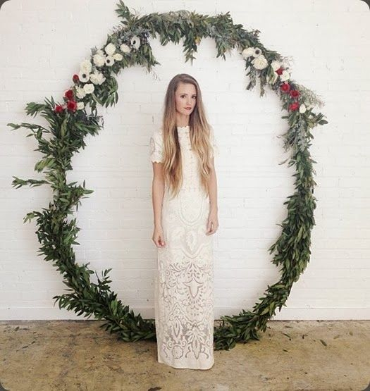 giant evergreen and flower wreath used for a ceremony backdrop
