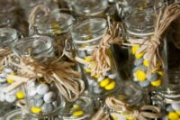 04 grey and yellow candies in jars for wedding favors
