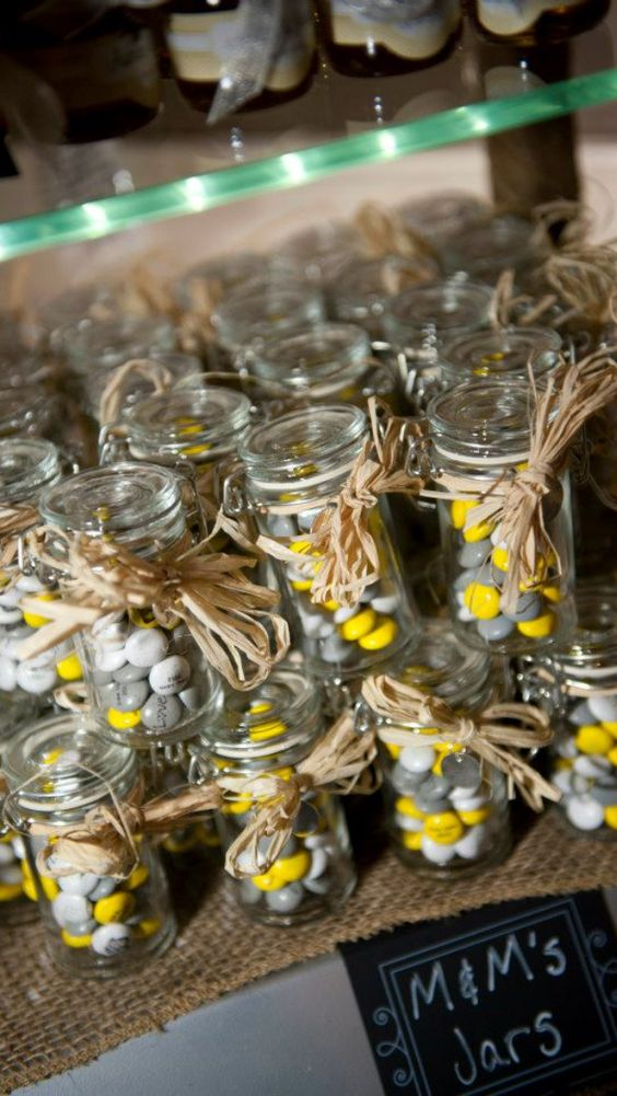 grey and yellow candies in jars for wedding favors