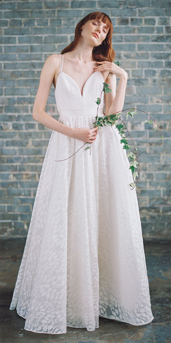 spaghetti strap wedding gown with petal print
