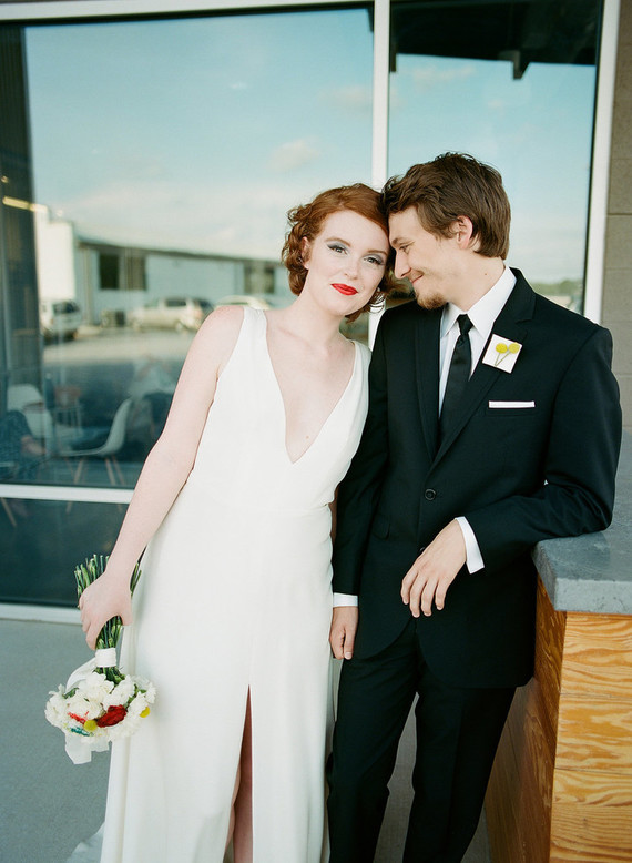 The bridal look was also minimalist, a high low dress with a plunging neckline, emerald shoes and a bold lip