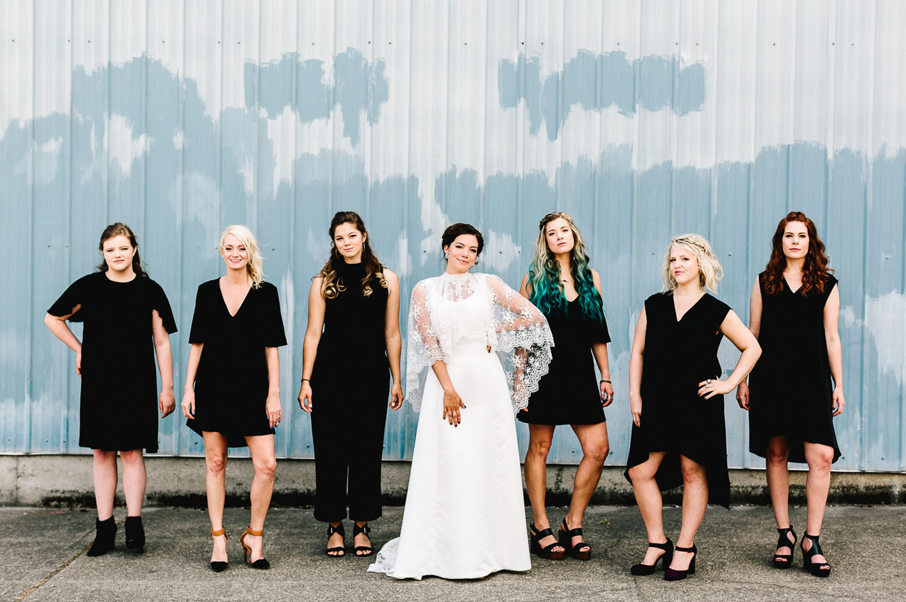 The bridesmaids were wearing black to make the bride in her ivory dress stand out