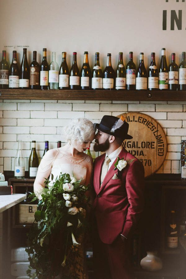 The groom rocked a rust-colored suit with a hat decorated with a feather