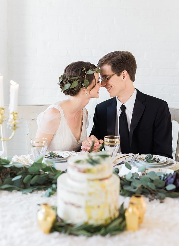 Picture Of The Groom Was Wearing A Black Tuxedo With A Tie And The Bride Looked Elegant