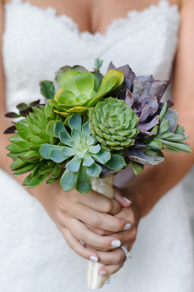 The wedding bouquet features a hot wedding trend - succulents