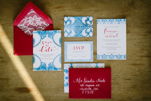 The wedding stationery was done in red and blue with lace touches mixing modern and traditional