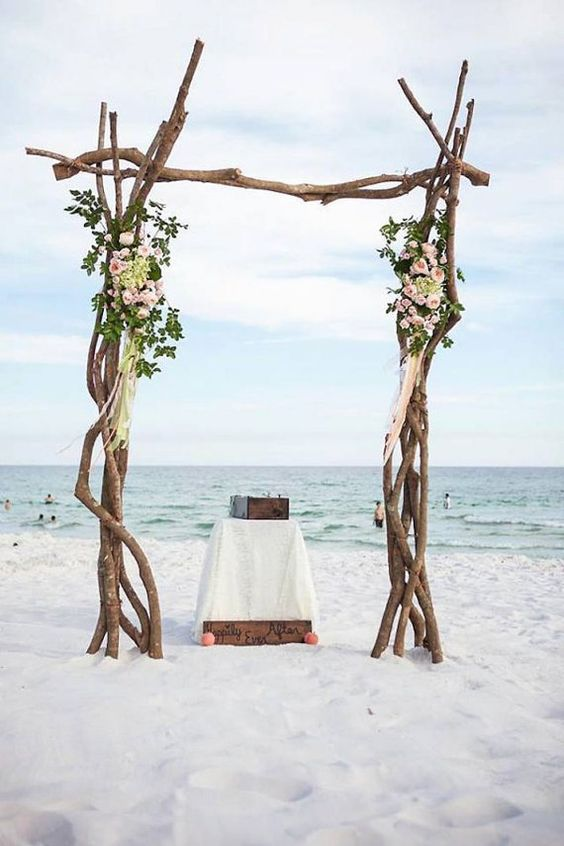 driftwood branches wedding arch with foliage and flowers