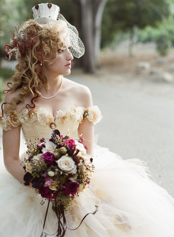 floral Victorian dress with a hat and a bold bouquet