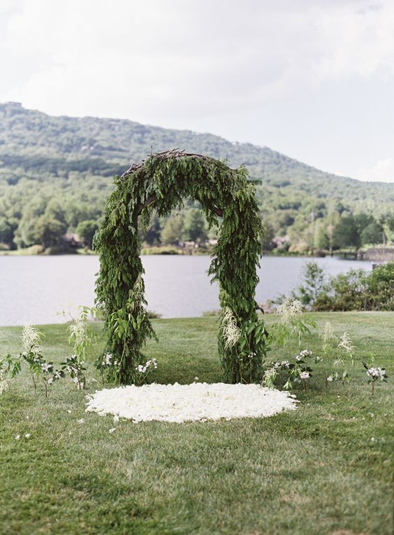 lush evergreen ceremony arch for a winter wedding