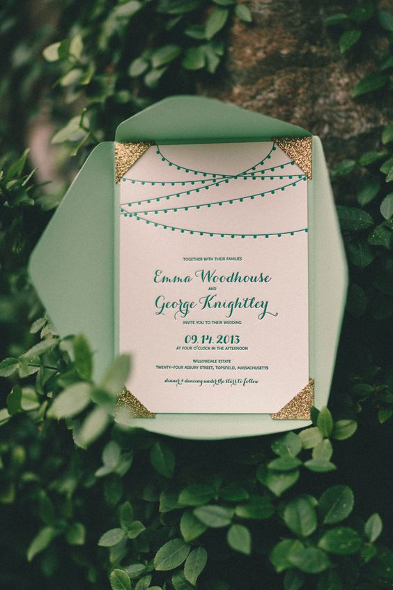 mint envelope with gold corners and an ivory invitation