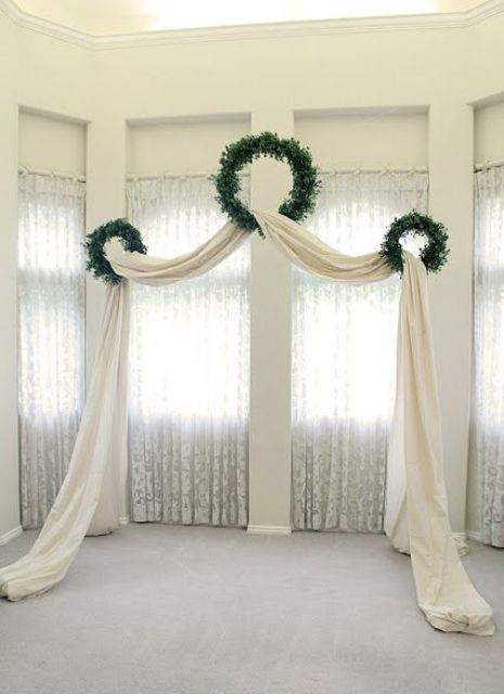 three wreaths and a curtain can become a wedding arch