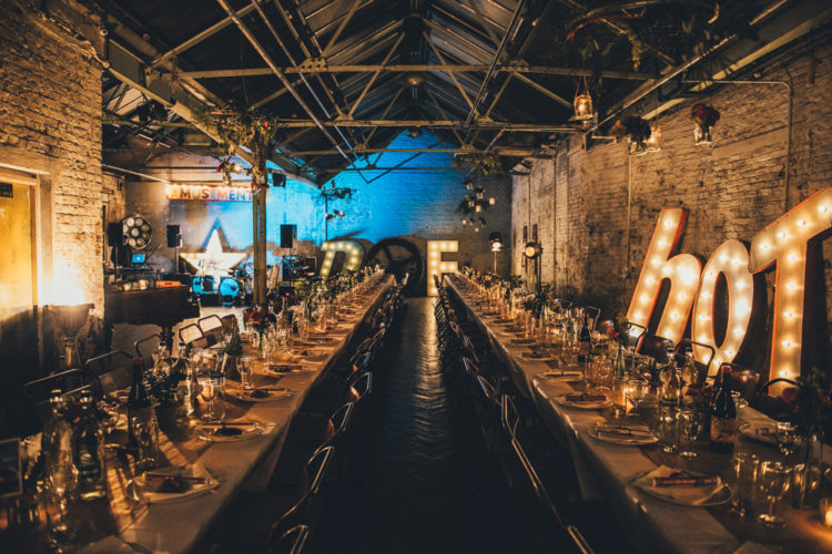 Industrial wedding venue was decorated with cool marquee lights