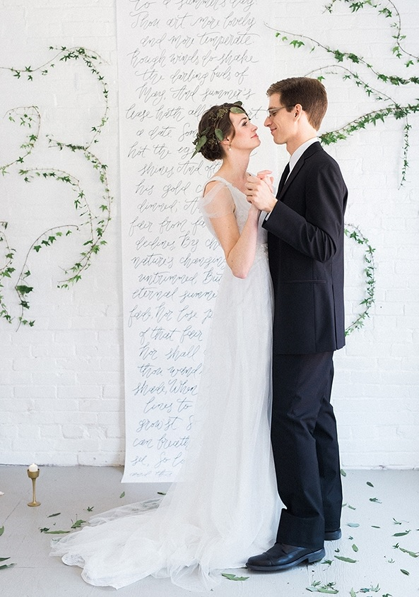 The backdrop was a calligraphy one with greenery garlands all over