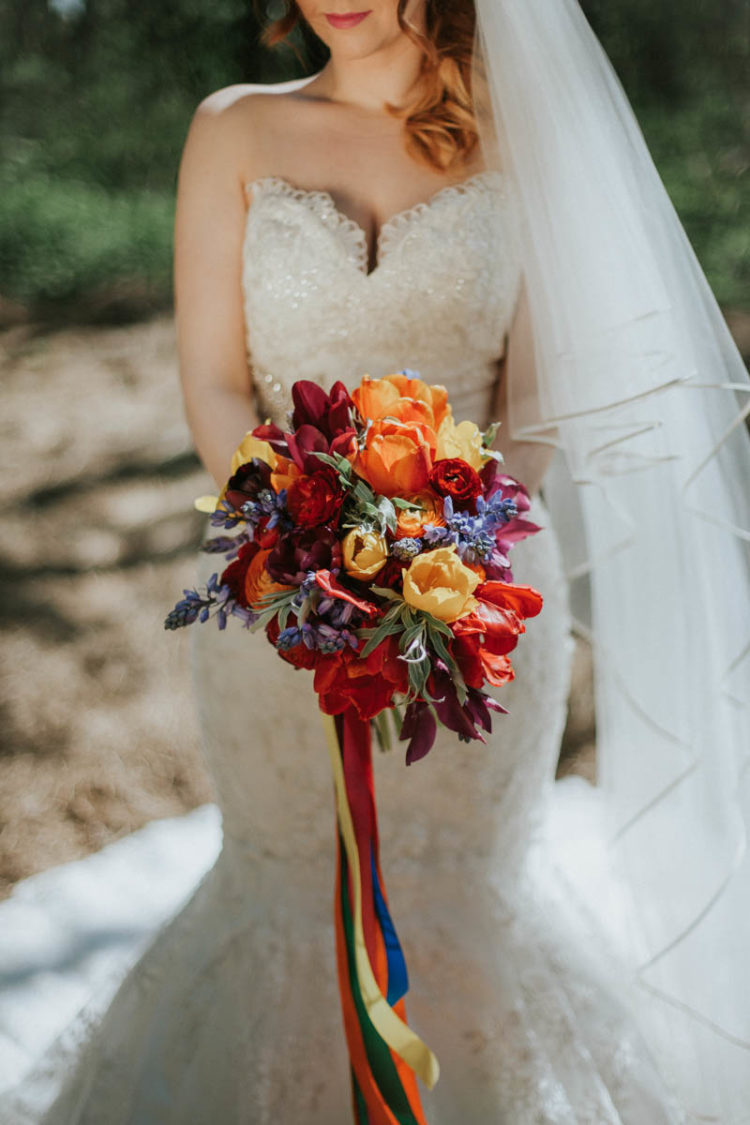 The bridal bouquet was a super bold one, in red, peach, yellow and lavender colors