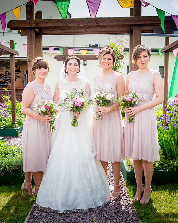 The bridesmaids were also wearing blush dresses