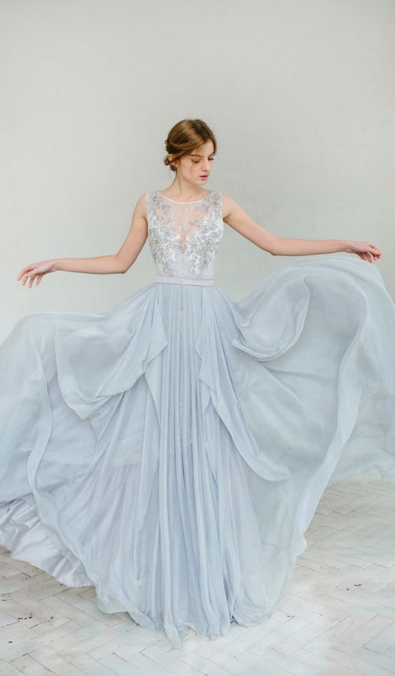 dusty blue wedding dress with a tulle skirt and a lace embellished top with an illusion neckline