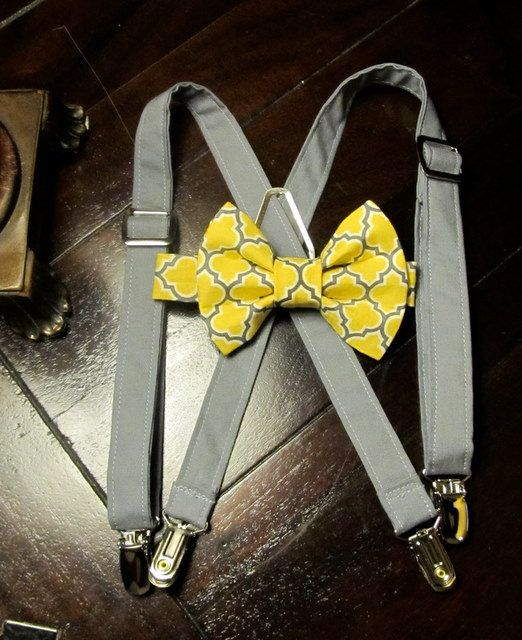 grey suspenders and a yellow and grey bow tie