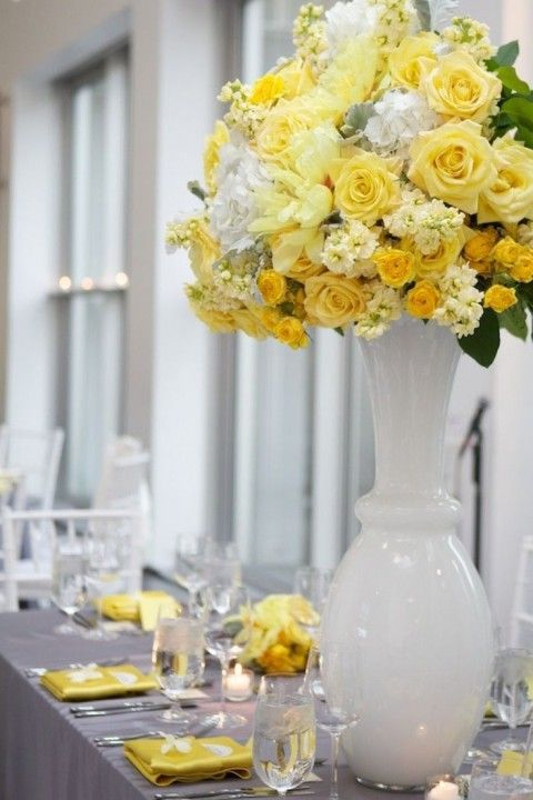 grey table with bold yellow florals and napkins