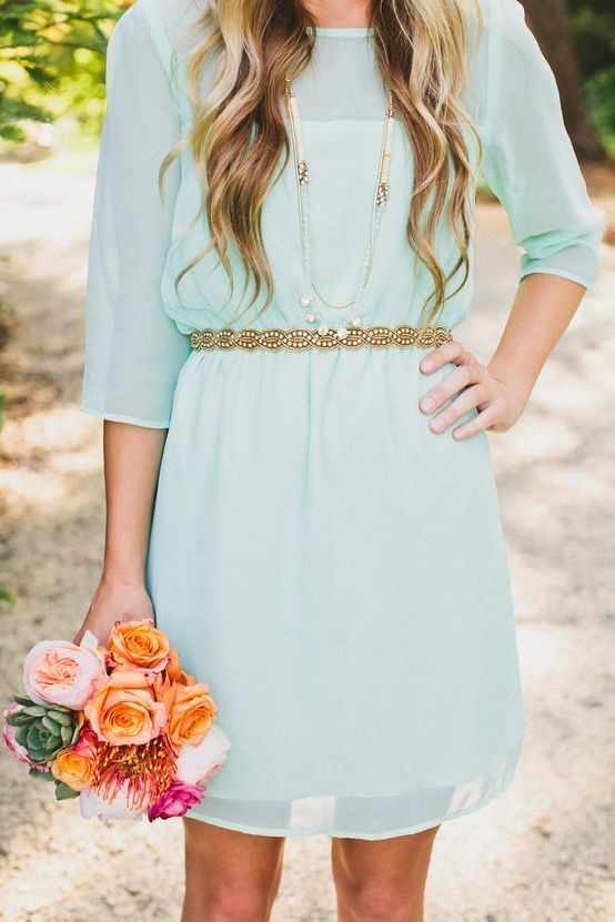 mint bridesmaid's dress with a gold sash