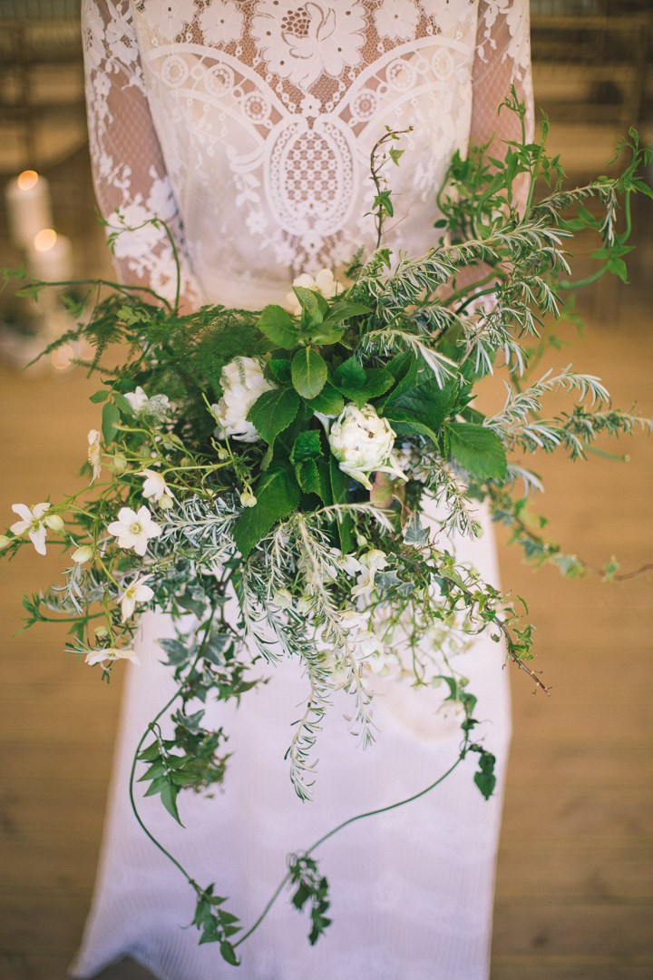 Her textural greenery bouquet fully reflected the forest wedding theme chosen
