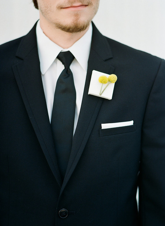 The groom's look was simple but a boutonniere was a unique one with a billy ball