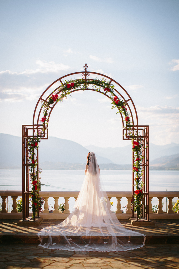 The wedding arch was a large metal one decorated with red flowers